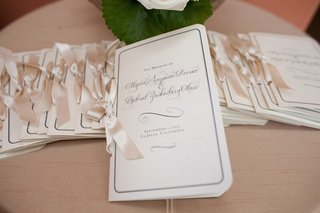 modern-calligraphy-ceremony-booklets-tied-with-ribbon