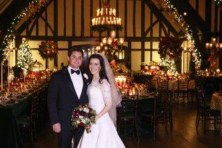 bride-in-oscar-de-la-renta-wedding-dress-with-groom-in-reception-room-with-holiday-theme
