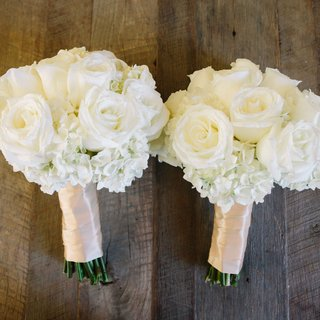 two-white-rose-hydrangea-nosegays-wrapped-in-pale-pink-ribbon-for-bridesmaids