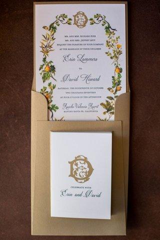 wedding-invitation-in-gold-envelope-gold-monogram-orange-and-greenery-motif-illustration-calligraphy