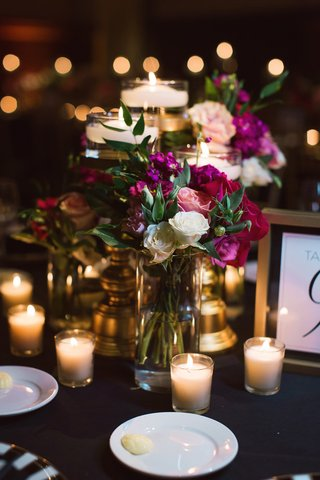 pink-black-and-white-wedding-reception-dark-pink-flowers-votive-candles-floating-candles