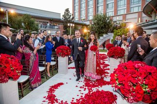 indian-bride-walking-with-dad-down-red-petal-aisle