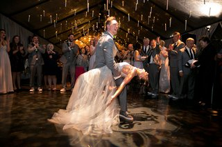 alexis-cozombolidis-and-hunter-pence-wedding-reception-dancing-on-dance-floor-first-dance-dip-candle