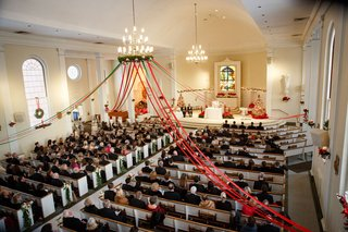 wedding-ceremony-at-church-in-cleveland-ohio-red-ribbon-hanging-from-chandelier-holiday-christmas