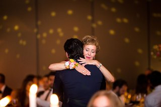 mother-son-dance-at-wedding-reception-mom-sweet-look-hugging-son