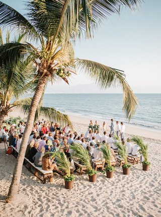 wedding-ceremony-on-sand-beach-in-mexico-ocean-view-palm-trees-palm-plants-benches-intimate-wedding