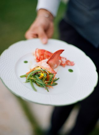 wedding-meal-lobster-with-champagne-sauce-and-pickled-veggies-on-white-plate-server-appetizer