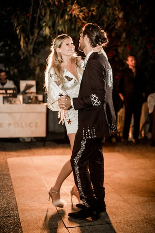 bride-in-minidress-with-star-motif-and-groom-in-embroidered-suit-for-first-dance-at-villa-lake-como