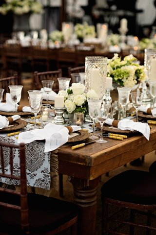 wedding-reception-with-country-table-damask-runner-with-brown-print-white-roses-candles