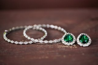 wedding-earring-hoops-and-studs-with-emerald-center-and-halo-of-diamond