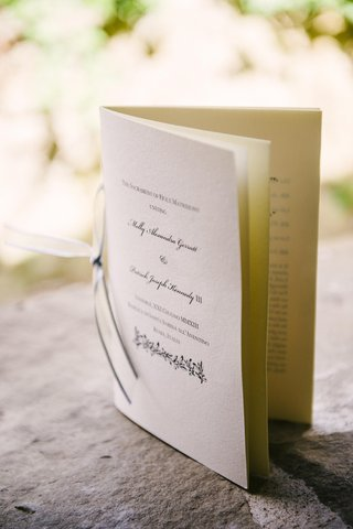 program-printed-on-white-paper-and-tied-with-ribbon