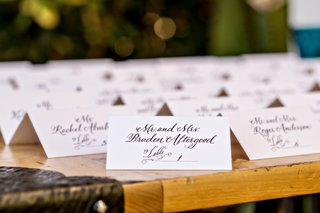 black-and-white-simple-tent-seating-cards-at-outdoor-wedding