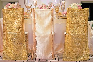 styled-shoot-with-gold-and-white-linen-chair-covers