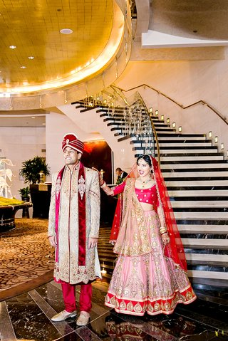 indian-american-bride-and-groom-in-traditional-wedding-attire-during-first-look