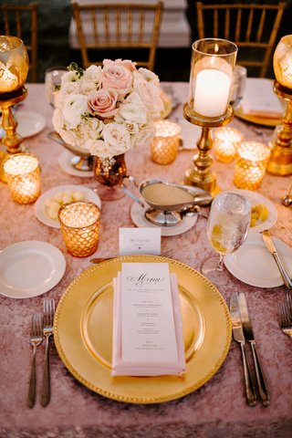 wedding-reception-tablescape-place-setting-gold-charger-plate-pink-tablecloth-gold-candle-low-flower