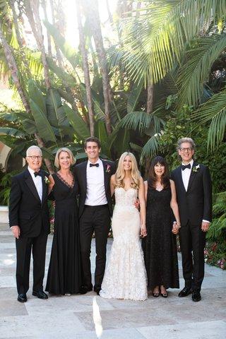 wedding-photo-of-bride-in-inbal-dror-wedding-dress-groom-tuxedo-parents-in-black-white-attire-luxury
