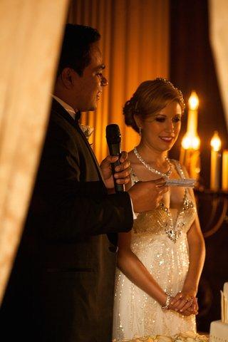 bride-in-a-sleeveless-jenny-packham-beaded-dress-with-groom-in-a-black-tuxedo