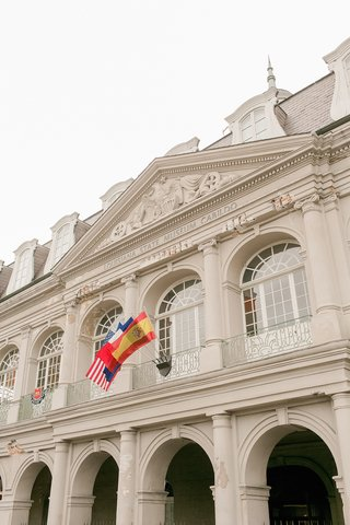 front-of-the-louisiana-state-museum-cabildo-spain-flag-france-flag-u-s-flag