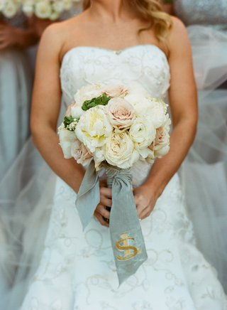 ivory-and-pink-wedding-bouquet-tied-with-monogrammed-ribbon