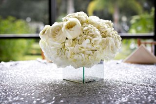 ivory-hydrangea-and-white-garden-rose-flower-arrangement-on-silver-sequin-wedding-table