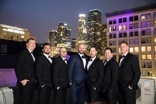 seattle-mariners-marc-rzepczynskis-wedding-groomsmen-on-roof-with-downtown-la-in-background