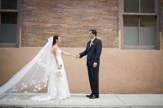 white-flower-applique-wedding-veil-on-bride