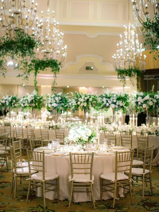 gold-chiavari-chairs-crystal-chandeliers-with-greenery