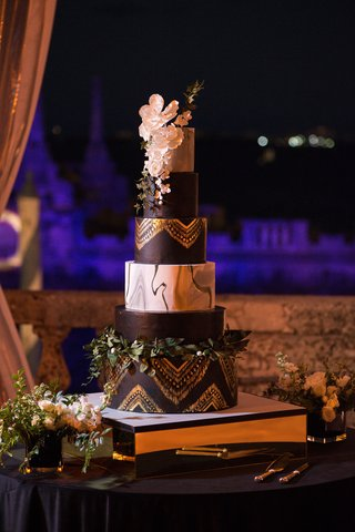 six-tier-wedding-cake-black-and-gold-tiers-marble-tier-sugar-flowers