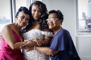 bride-in-off-shoulder-wedding-dress-with-mom-and-grandma-before-wedding-ceremony