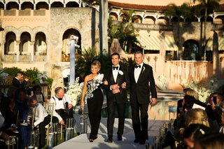 groom-in-tuxedo-with-mother-of-groom-in-one-shoulder-gown-black-mar-a-lago-club