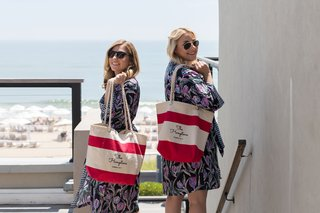 bridesmaids-in-robes-sunglasses-with-red-white-stripe-bag-with-rope-handles