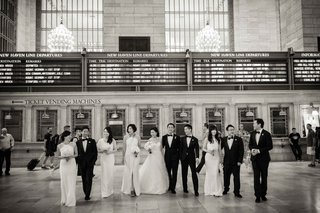 black-and-white-photo-of-bride-and-groom-with-bridesmaids-and-groomsmen-at-grand-central-station