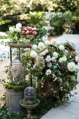 wedding-ceremony-wood-aisle-entrance-with-lantern-wood-table-peach-fruits-white-dahlia-rose