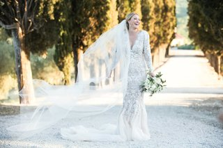 bride-in-marchesa-wedding-dress-long-sleeves-v-neck-mermaid-cathedral-veil
