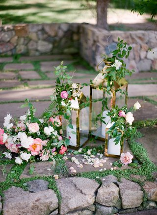 gold-lanterns-with-candles-and-green-vines-pink-peony-white-rose-flowers