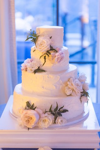 wedding-cake-with-fresh-flowers-buttercream-frosting-delicious-cake-simple-four-layer-option
