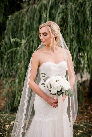 bride-posing-modified-trumpet-gown-sweetheart-neckline-strapless-lace-beading-veil-portland-wedding