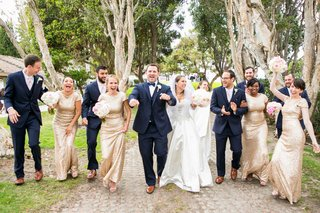bride-in-allure-ball-gown-groom-in-navy-joseph-abboud-suit-bridesmaids-in-gold-sorella-vita