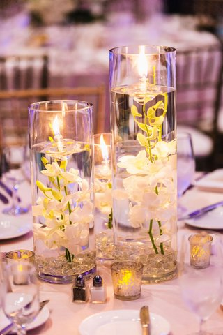 submerged-orchids-with-floating-candles-as-centerpieces-at-wedding-reception