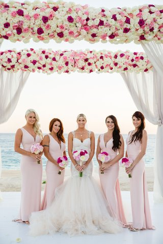 bridesmaids-at-barbie-blanks-destination-beach-wedding-pink-dresses-and-flowers