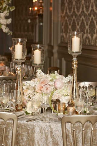 texture-wedding-linens-with-gold-candle-votives-pillar-candles-on-stands-white-pink-flowers