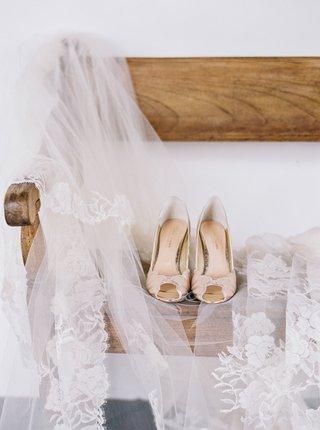 bhldn-peep-toe-scallop-wedding-heel-on-wood-bench-with-peter-langner-veil-guatemala-wedding