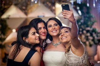 bride-friends-taking-selfie-wedding-reception-fun-bridesmaids-social-media-iphone-technology