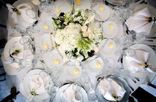 all-white-table-decorated-with-bouquet-of-greenery