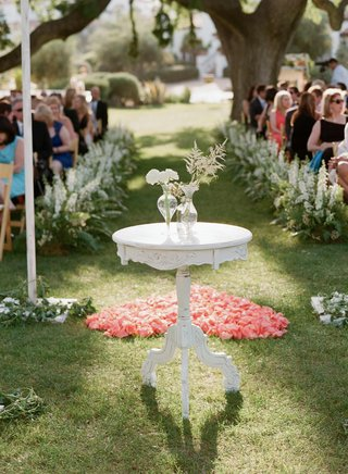 shabby-chic-white-altar-table-in-front-of-flower-petal-heart