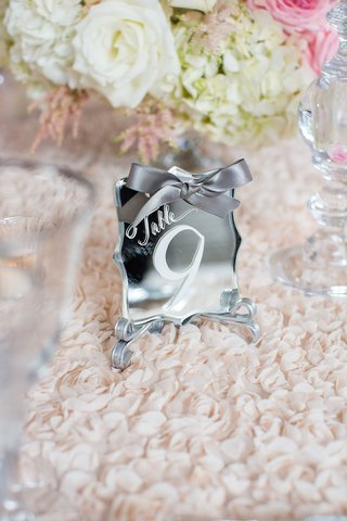 mirror-table-number-die-cut-white-calligraphy-and-grey-ribbon-textured-linens