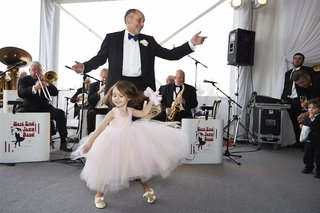 flower-girl-in-pink-flower-girl-dress-dancing-with-father-of-bride