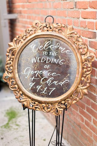 wedding-welcome-sign-genevie-and-chad-calligraphy-gold-frame-old-vintage-mirror