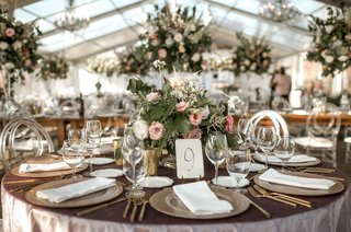 wedding-reception-clear-tent-round-table-and-high-low-centerpieces-chandeliers-heatherlily