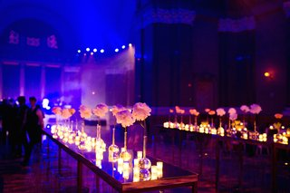 long-table-with-single-bloom-vases-and-bright-lighting